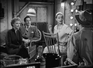Margot (Bette Davis), Lloyd Richards (Hugh Marlowe) and Karen (Celeste Holm) are enthralled by Eve (Anne Baxter)'s sad life story in Joseph L. Mankiewicz's All About Eve (1950)