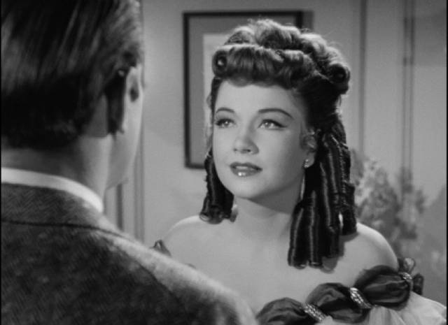At her moment of triumph, Eve (Anne Baxter) discovers the power Addison (George Sanders) has over her in Joseph L. Mankiewicz's All About Eve (1950)