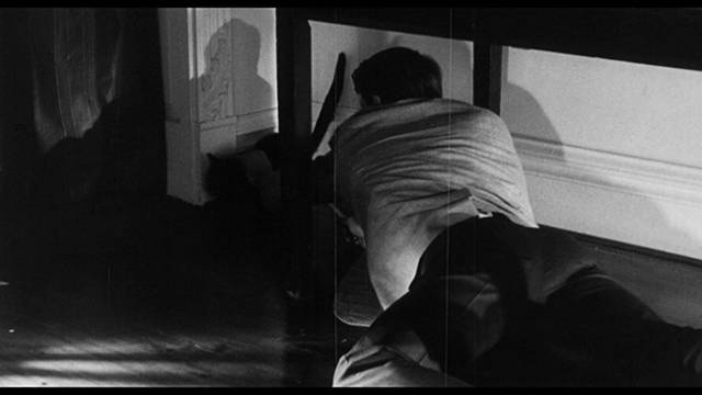 Lou (Robert Frost) decides he needs to kill the cat in Harold Hoffman's The Black Cat (1966)