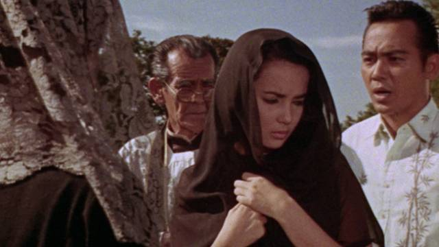 Charito (Amalia Fuentes) is in danger from the head vampire in Gerardo De Leon's The Blood Drinkers (1964)