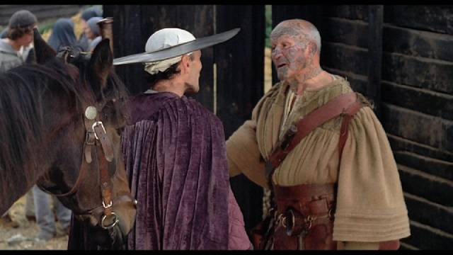 Chaucer (Pier Paolo Pasolini) chats with one of the pilgrims in Pier Paolo Pasolini's The Canterbury Tales (1972)