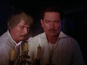 Eduardo (Eddie Garcia) is shown the family secret by his father (Johnny Monteiro) in Gerardo De Leon's Curse of the Vampires (1966)