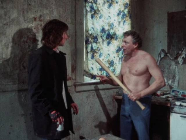 Goose (Jim Van Bebber) visits his junkie father (Charlie Goetz) in Deadbeat at Dawn (1988)