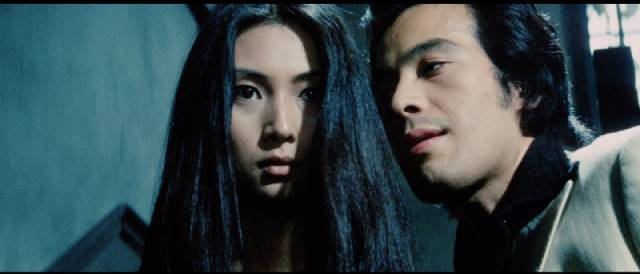 Nami (Meiko Kaji) is abused by a gang in Shunya Ito's Female Prisoner Scorpion: Beast Stable (1973)