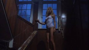 A seductive zombie lures unwary travellers to the doom in William A. Levey's Hellgate (1989)
