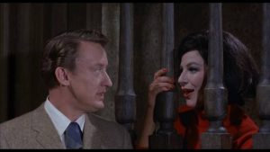 Tom Penderel (Tom Poston) is pursued aggressively by Morgana Femm (Fenella Fielding) in William Castle's The Old Dark House (1963)