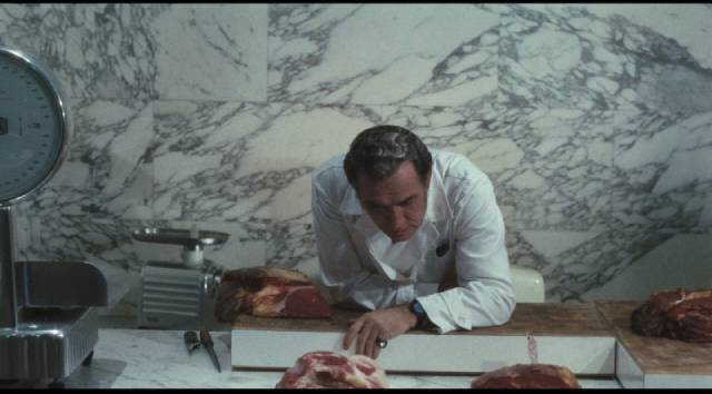 The Butcher (Ugo Tognazzi) rules over his domain with arrogant dishonesty in Elio Petri's Property Is No Longer a Theft (1973)