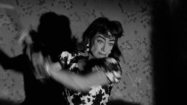 Lucy (Joan Crawford)'s history of axe-murdering casts suspicion on her in William Castle's Strait-Jacket (1964)