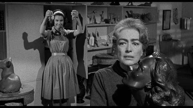 Lucy Harbin (Joan Crawford) is insecure with her estranged daughter Carol (Diane Baker) in William Castle's Strait-Jacket (1964)