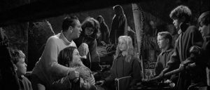 Simon (Macdonald Carey) and Joan (Shirley Anne Field) discover the strange children in their secret cave in Joseph Losey's The Damned (1962)