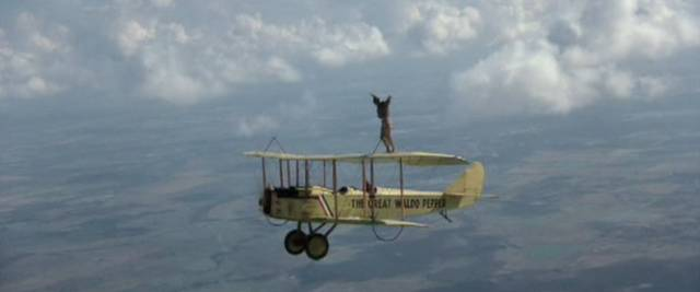 Waldo and Axel (Bo Svenson) practive wing-walking in George Roy Hill's The Great Waldo Pepper (1975)