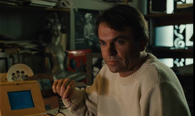 Claire (Solveig Dommartin)'s lover Eugene (Sam Neill) begins writing her story in Paris in Wim Wenders' Until the End of the World (1991)