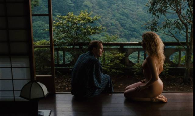 Sam (William Hurt) and Claire (Solveig Dommartin) pause for recovery in Japan in Wim Wenders' Until the End of the World (1991)