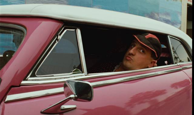 Chico (Chick Ortega) enjoys the material benefits of the U.S. in San Francisco in Wim Wenders' Until the End of the World (1991)