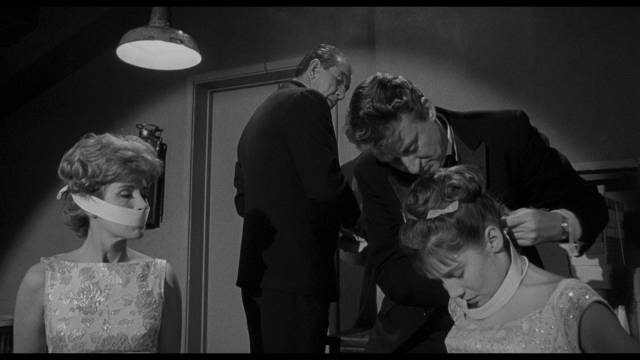Russian agents resort to kidnapping in their attempts to get hold of the coin in William Castle's Zotz! (1962)