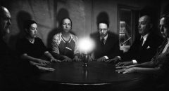 A seance under the guidance of psychic investigator Harry Price tries to contact the ghosts in Ashley Thorpe's Borley Rectory (2017)