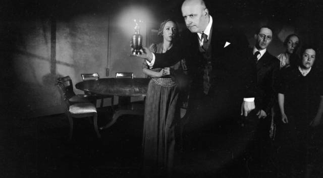 The seance conjures mysterious noises in Ashley Thorpe's Borley Rectory (2017)
