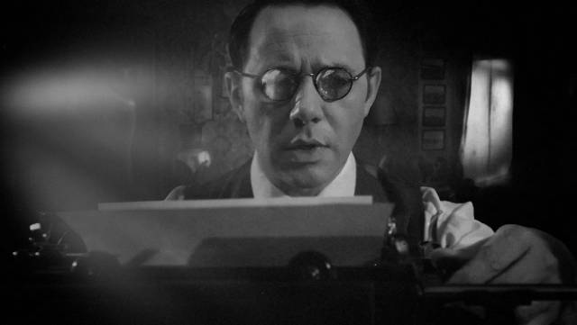 V.C. Wall (Reece Shearsmith) writes an article for the Daily Mirror in Ashley Thorpe's Borley Rectory (2017)