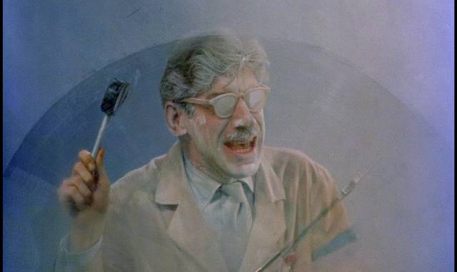 Dr. Hubertus (Michael Fox) trapped in his own freezer in Herbert L. Strock's Gog (1954)