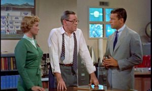 Agent Sheppard (Richard Egan) meets project head Dr. Van Ness (Herbert Marshall) in Herbert L. Strock's Gog (1954)