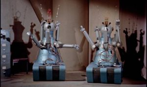 The robots Gog and Magog are being controlled by sinister forces in Herbert L. Strock's Gog (1954)