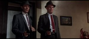 Madigan (Richard Widmark) and his partner Rocco Bonaro (Harry Guardino) drop in on a suspect in Don Siegel's Madigan (1968)