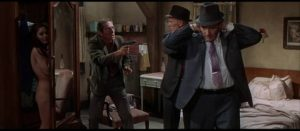 Killer Barney Benesh (Steve Ihnat) gets the drop on Madigan (Richard Widmark) and his partner Rocco Bonaro (Harry Guardino) in Don Siegel's Madigan (1968)
