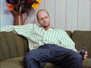 Serial killer Lothar Schramm (Florian Koerner von Gustorf) relaxes at home in Jörg Buttgereit's Schramm (1993)