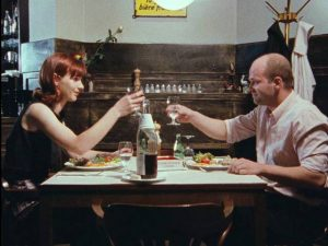 Neighbour Marianne (Monika M.) treats Schramm (Florian Koerner von Gustorf) to a nice restaurant dinner in Jörg Buttgereit's Schramm (1993)