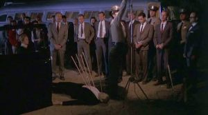 The crime is reenacted for the jury in Harold Becker's The Onion Field (1979)
