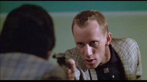 Petty thief Gregory Powell (James Woods) has a hair-trigger temper in Harold Becker's The Onion Field (1979)
