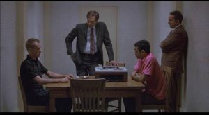 Gregory Powell (James Woods) and Jimmy Lee Smith (Franklyn Seales) are confronted by detectives in Harold Becker's The Onion Field (1979)