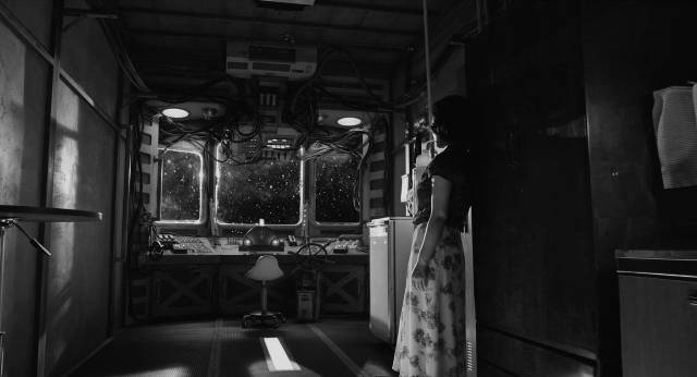 Robot courier Yoko Suzuki (Megumi Kagurazaka) waits patiently between stops in Sion Sono's The Whispering Star (2015)