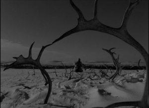 Pirita (Mirjami Kuosmanen) visits a sacred rock to make her sacrifice in Erik Blomberg's The White Reindeer (1952)