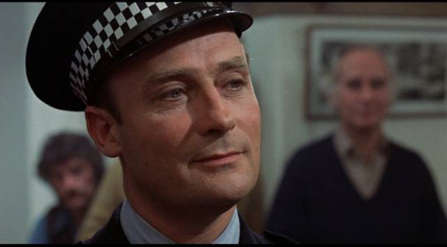 Sergeant Howie (Edward Woodward) looks on the islanders with smug condescension in Robin Hardy's The Wicker Man (1973)