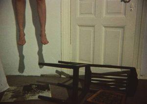 An otherwise unseen woman ends her life inJörg Buttgereit's Der Todesking (1990)