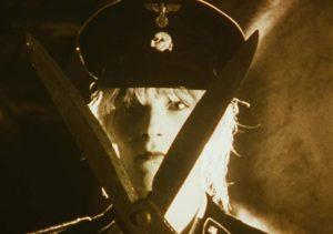 A parody of sleazy VHS Nazisploitation movies in Jörg Buttgereit's Der Todesking (1990)