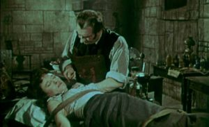 Callistratus (Donald Wolfitt) performs blood experiments to prolong his own life in Henry Cass' Blood of the Vampire (1958)