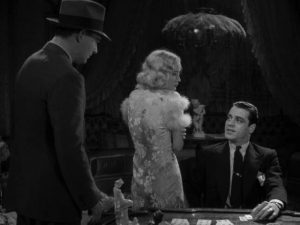 Temple (Miriam Hopkins) turns her back on suitor Stephen Benbow (William Gargan) to protect him from Trigger (Jack La Rue) in Stephen Roberts' The Story of Temple Drake (1933)