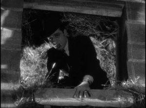 Trigger (Jack La Rue), a predatory monster in Stephen Roberts' The Story of Temple Drake (1933) ...