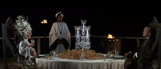 Mrs. Goforth (Elizabeth Taylor) dines on the terrace with the Witch of Capri (Noel Coward) in Joseph Losey's Boom (1968)