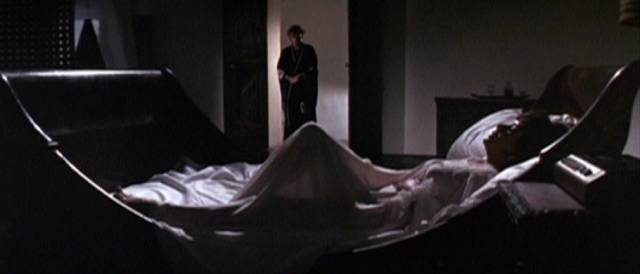Mrs. Goforth (Elizabeth Taylor) finally invites death (Richard Burton) into her boudoir in Jospeh Losey's Boom (1968)