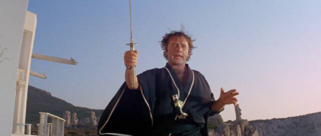 Flanders (Richard Burton) waves his katana around like an amateur bringer of death in Joseph Losey's Boom (1968)