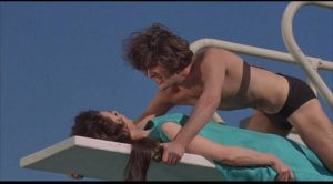 Singer Bogart Peter Stuyvesant (Jordan Christopher) seduces the world's wealthiest woman Astrid Steele (Jennifer Jones) in Robert Thom's Cult of the Damned (1969)