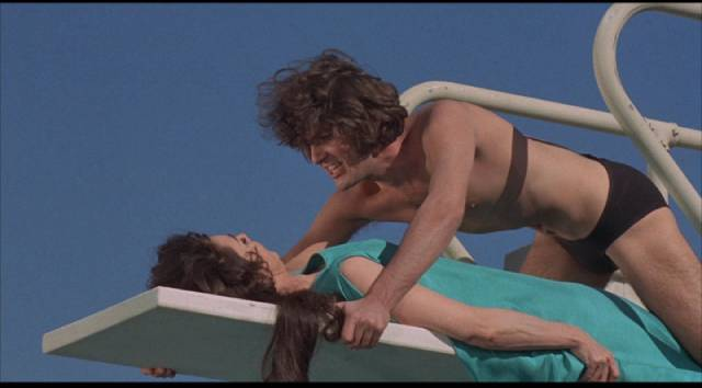 Singer Bogart Peter Stuyvesant (Jordan Christopher) seduces the world's wealthiest woman Astrid Steele (Jennifer Jones) in Robert Thom's Cult of the Damned (1969)