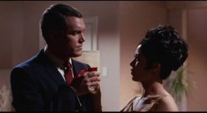 Agent Justin Power (Jeffrey Hunter) doesn't know if he can trust Kitty (France Nuyen) in Franklin Adreon's Dimension 5 (1966)
