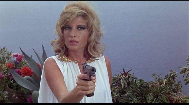 Monica Vitti lets the gun do the acting in Joseph Losey's Modesty Blaise (1966)