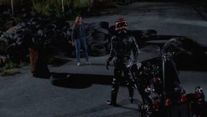 The phantom biker menaces heroine Gail (Sarah Buxton) in Umberto Lenzi's Nightmare Beach (1988)