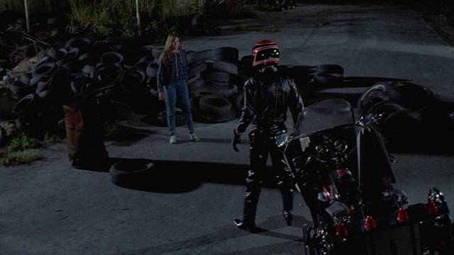 The phantom biker menaces heroine Gail (Sarah Buxton) in Umberto Lenzi's Nightmare Beach (1988)