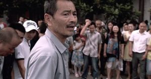 Lao Shi (Gang Chen) tries to do the right thing after a traffic accident in Johnny Ma's Old Stone (2016)